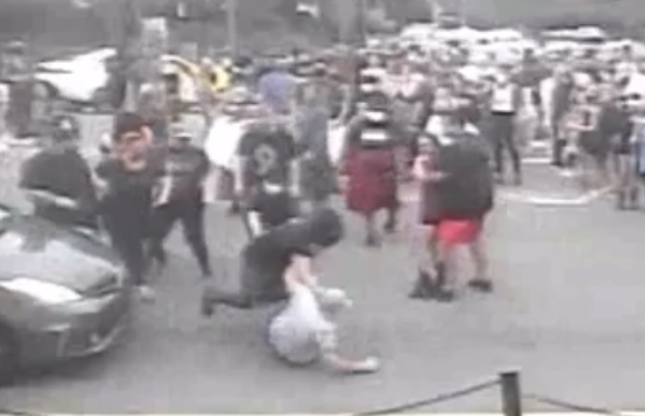 Video Shows Five Protesters Attacking, Kicking Man that Brandished Gun